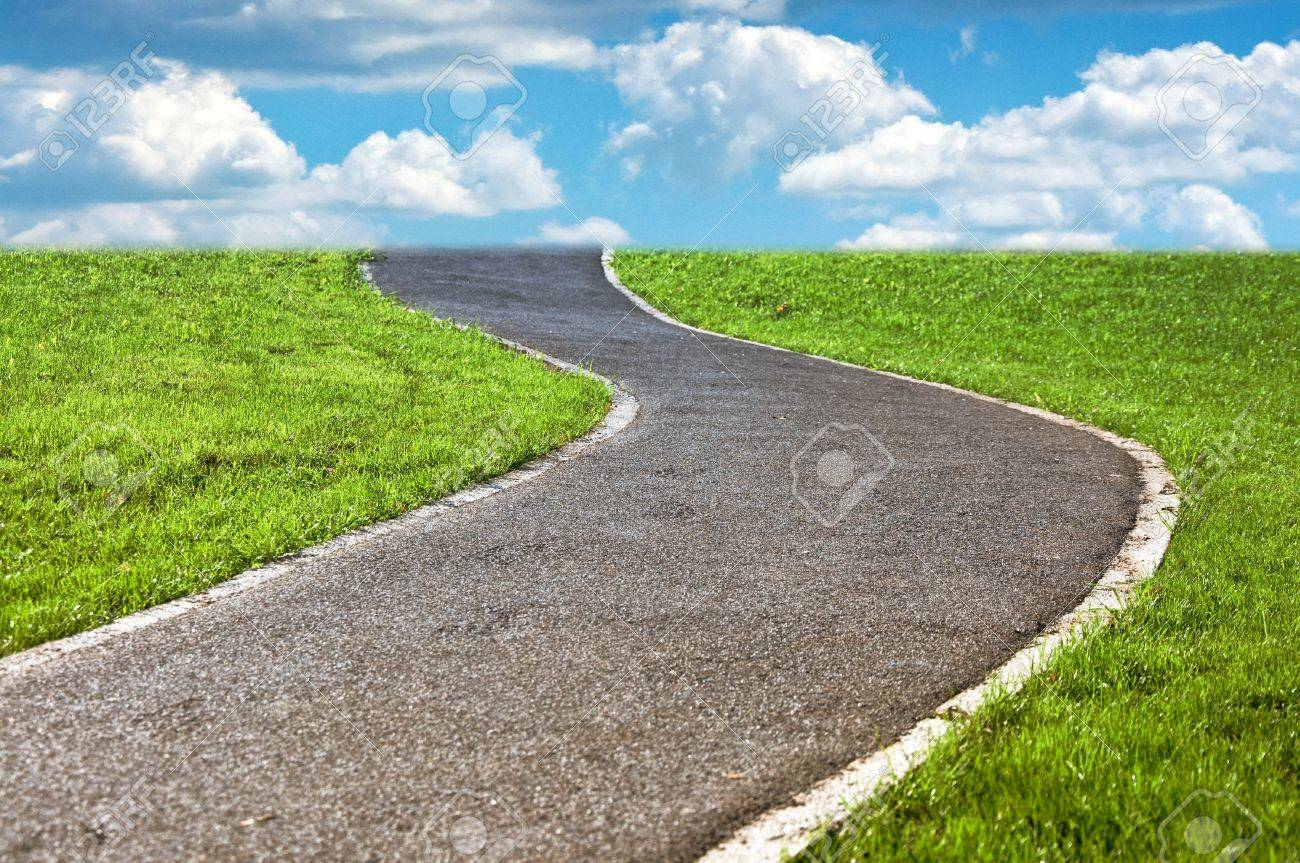 Narrow Winding Pathway In A Lush Green Grass Stock Photo, Picture ...