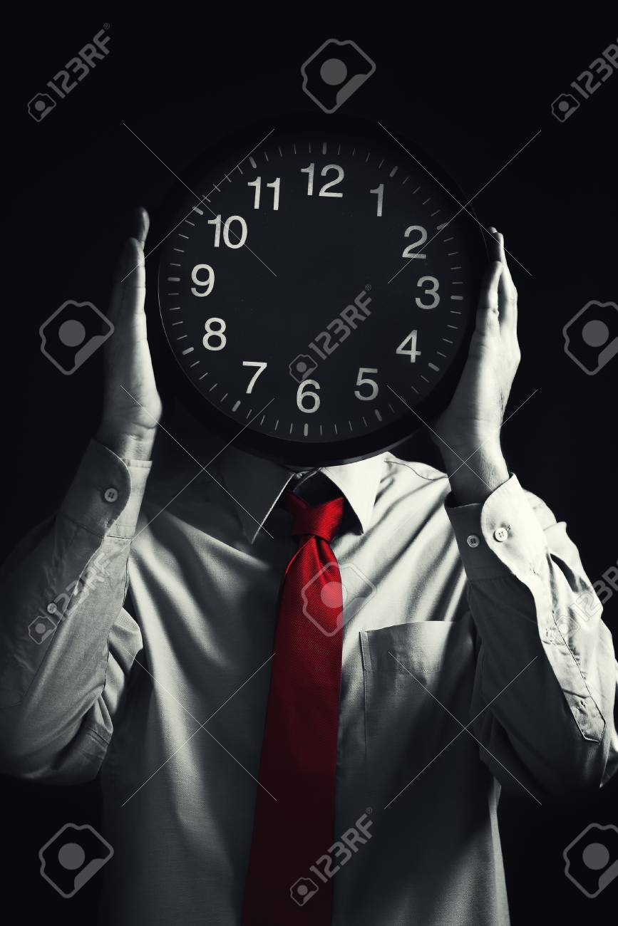 Businessman with black clock in front of his head, deadline concept. Not enough time to finish the job. Selective saturation of a red tie. Stock Photo - 17668624