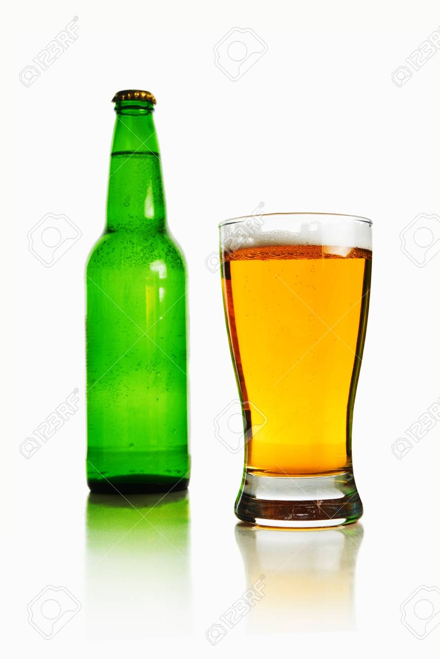 Beer bottle and glass full of light beer over a white background Stock Photo - 18975011