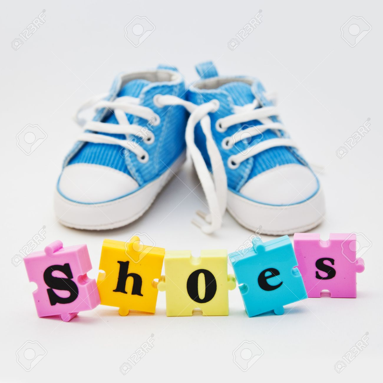 Blue baby shoes and a word puzzle pieces forming a word shoes stock blue baby shoes and a word puzzle pieces forming a word shoes stock photo 18975059 publicscrutiny Images