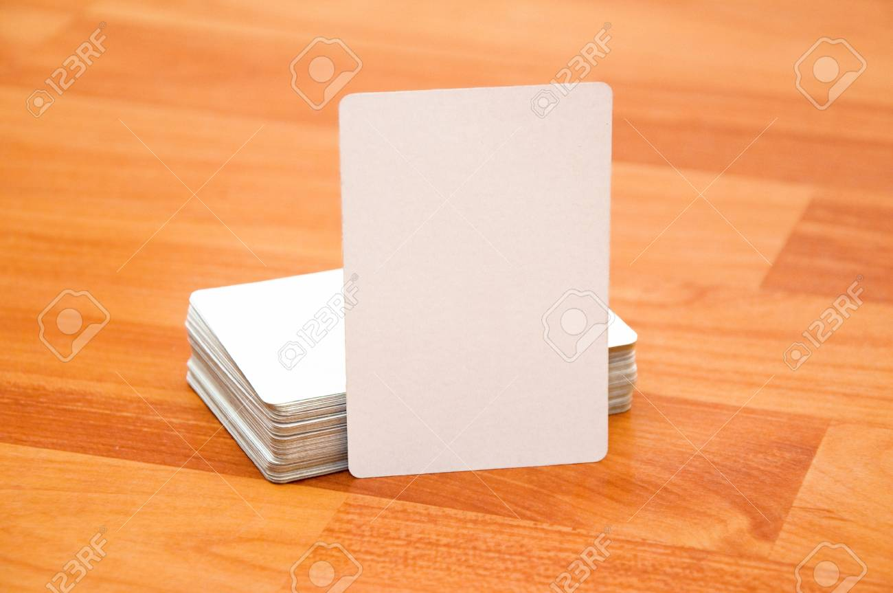 Stack of business cards with rounded corners over a wooden stack of business cards with rounded corners over a wooden background stock photo 21772801 reheart Image collections