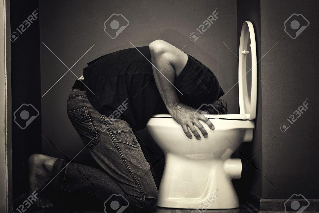 22536612-Man-vomiting-in-toilet-bowl-Stock-Photo-vomit-drunk-sick.jpg