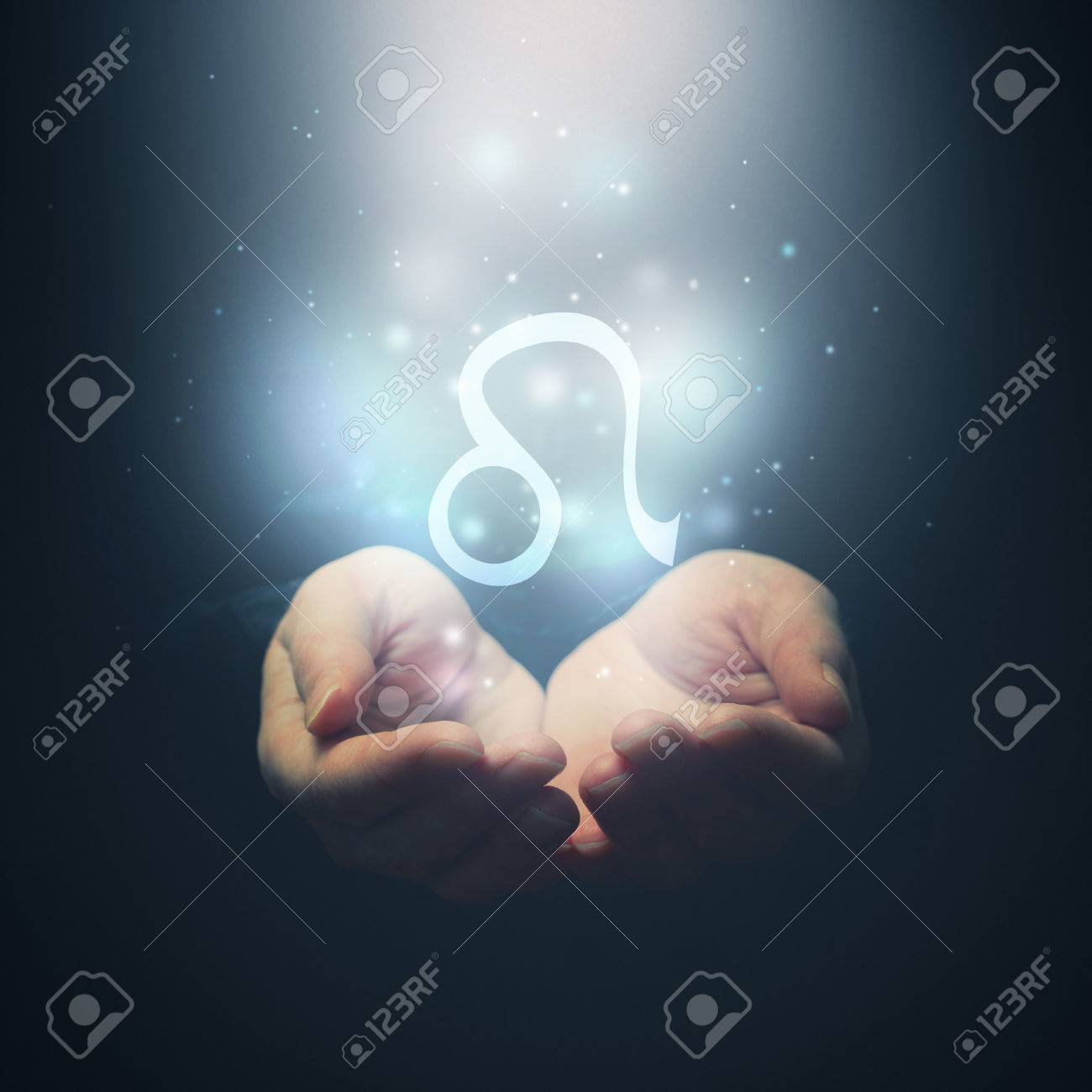 Female hands opening to light and holding zodiac sign for leo female hands opening to light and holding zodiac sign for leo horoscope symbols selective focus stock biocorpaavc