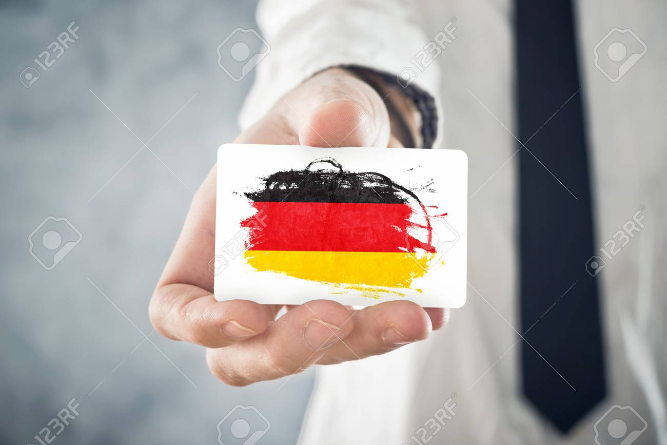 German Businessman holding business card with Germany Flag International cooperation, investments, business opportunities concept - 25887345