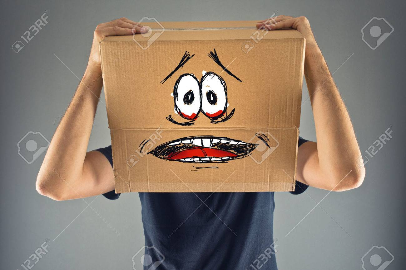 Man with cardboard box on his head and terrified look skethed. terrified; frozen; scared man. - 27334841