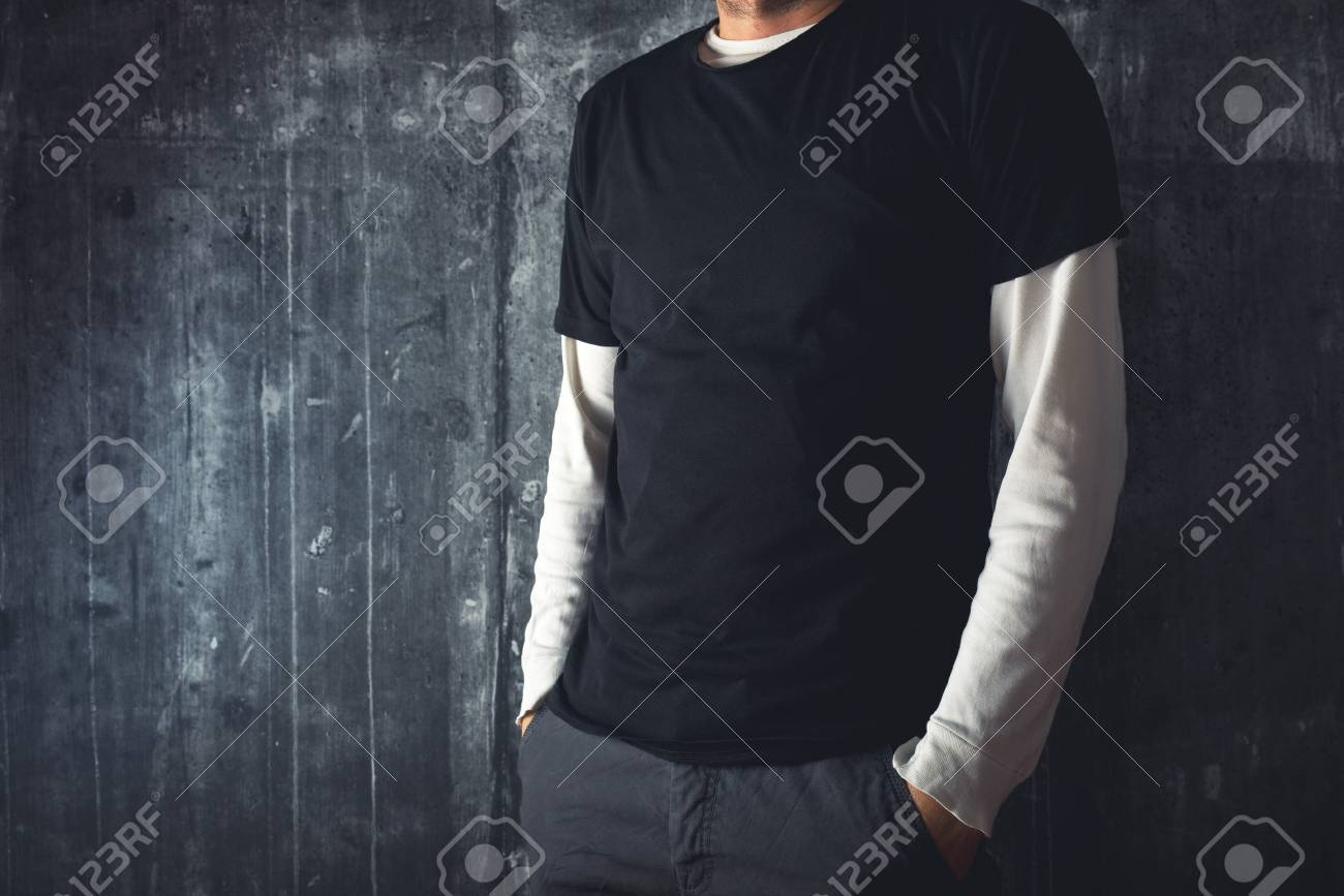 Slim tall man posing in blank black t-shirt as copy space for your text or design. - 30109105