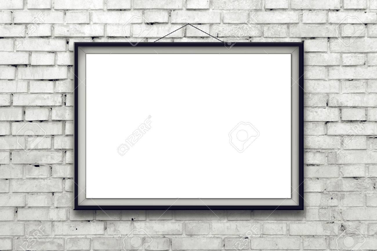 Blank horizontal painting poster in black frame hanging on white brick wall. Painting proportions match international paper size A. - 31072707