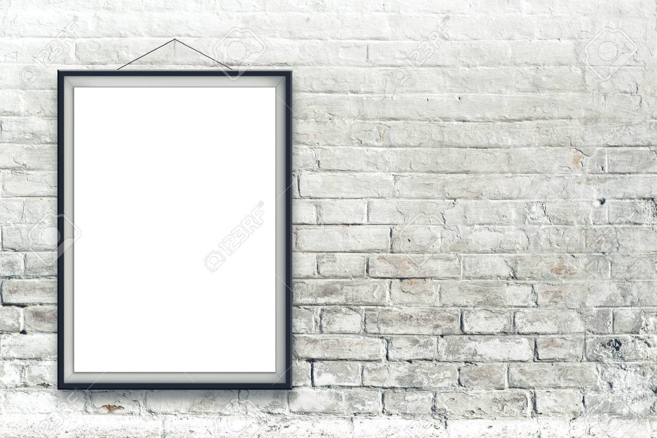Blank vertical painting poster in black frame hanging on white brick wall. Painting proportions match international paper size A. - 31906351