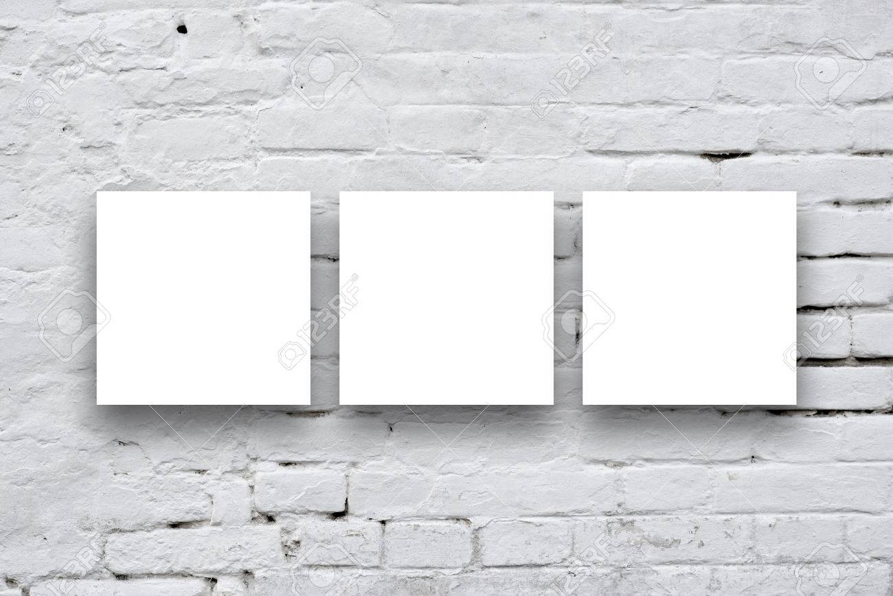 Three Square Posters hanging on the art gallery white wall. - 32019522