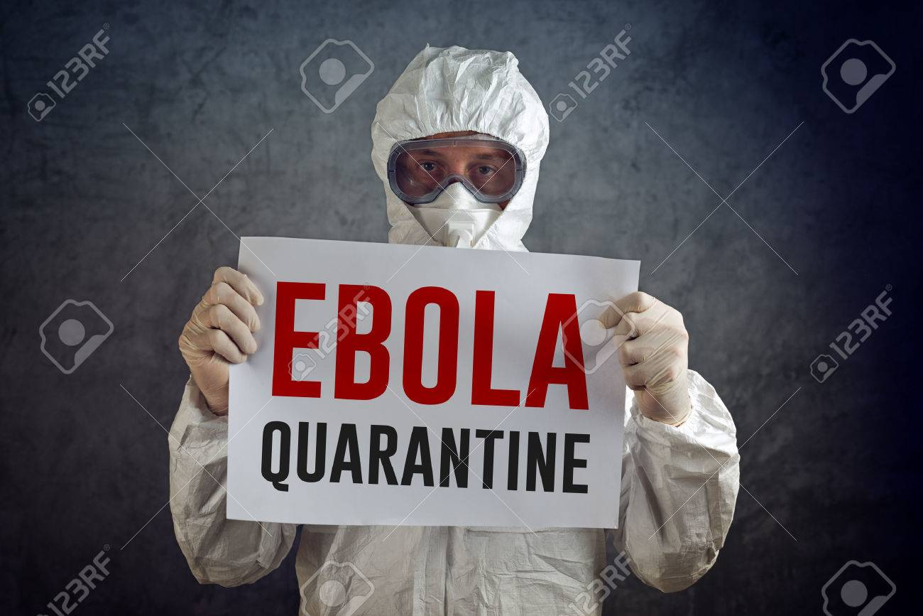 Ebola Quarantine sign held by medical healh care worker wearing protective gown, glowes, mask and goggles. - 32482710