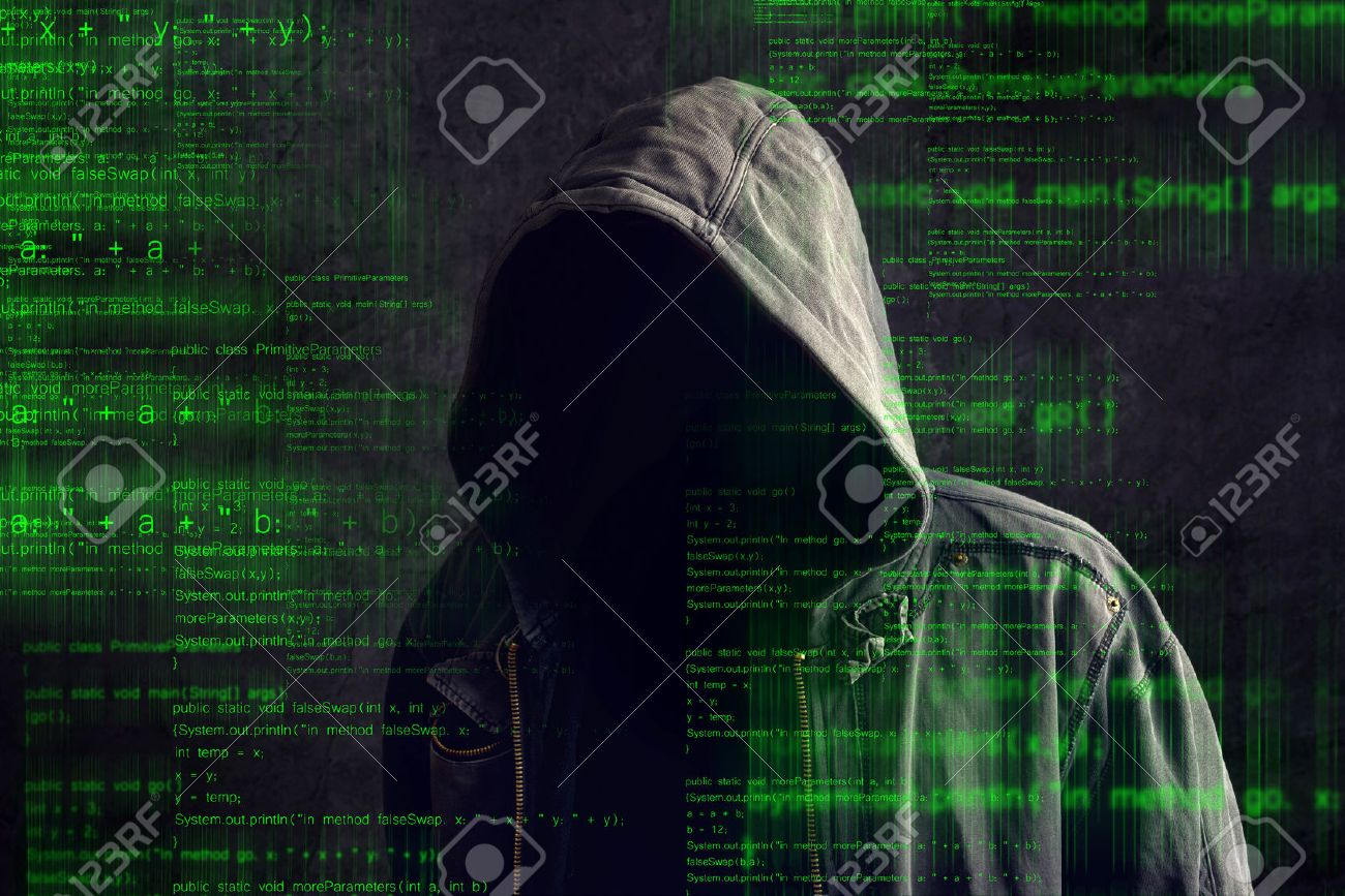 Faceless hooded anonymous computer hacker with programming code from monitor - 33042321