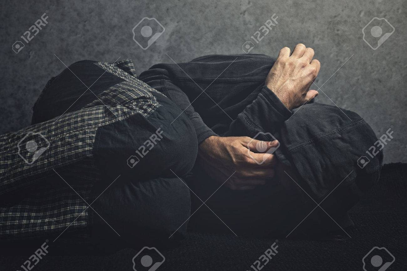 Drug Addict laying on the floor in agony, having an addiction crisis - 33150968