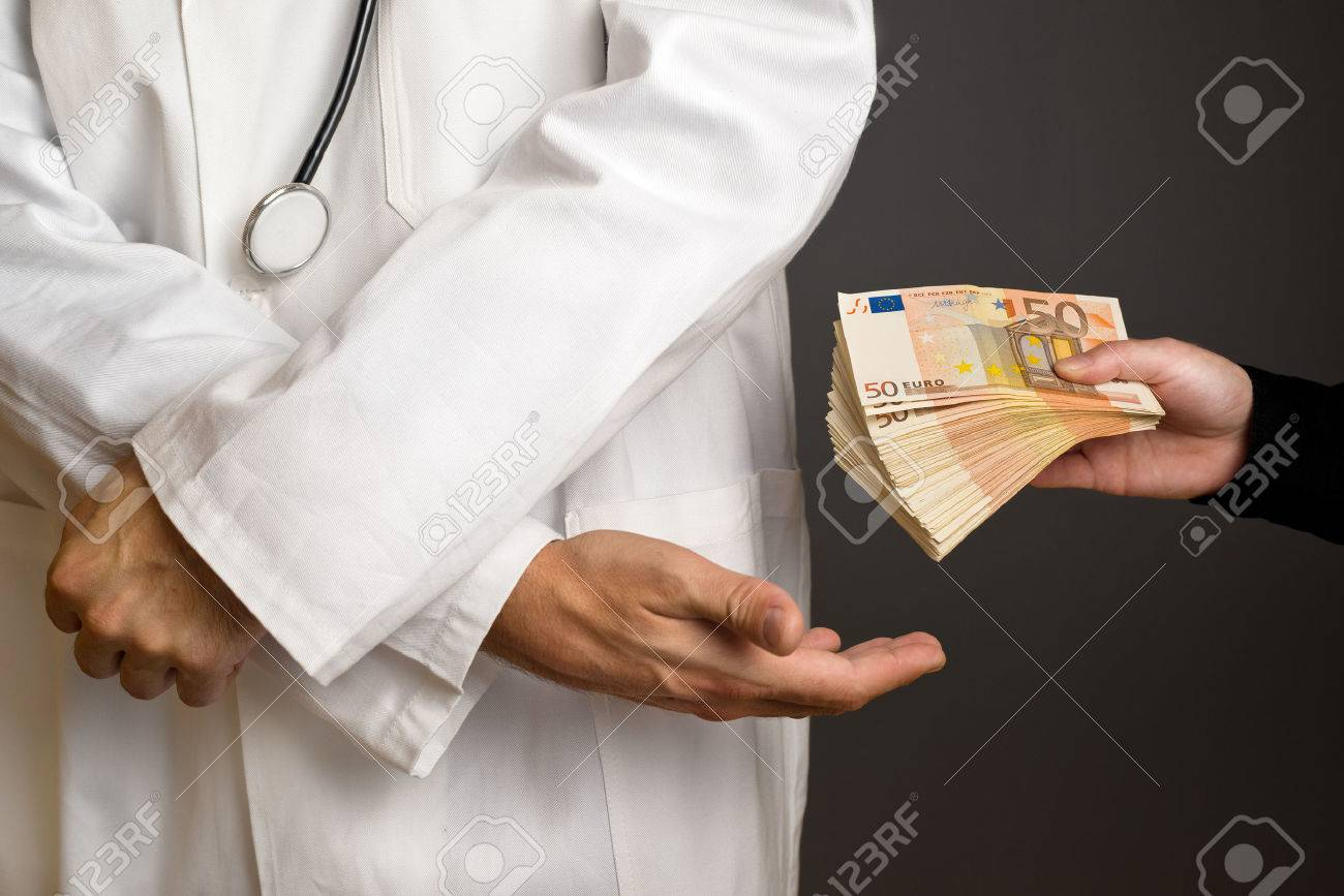 Corruption in Health Care Industry, Doctor receivening large amount of Euro banknotes as a bribe. - 33383871