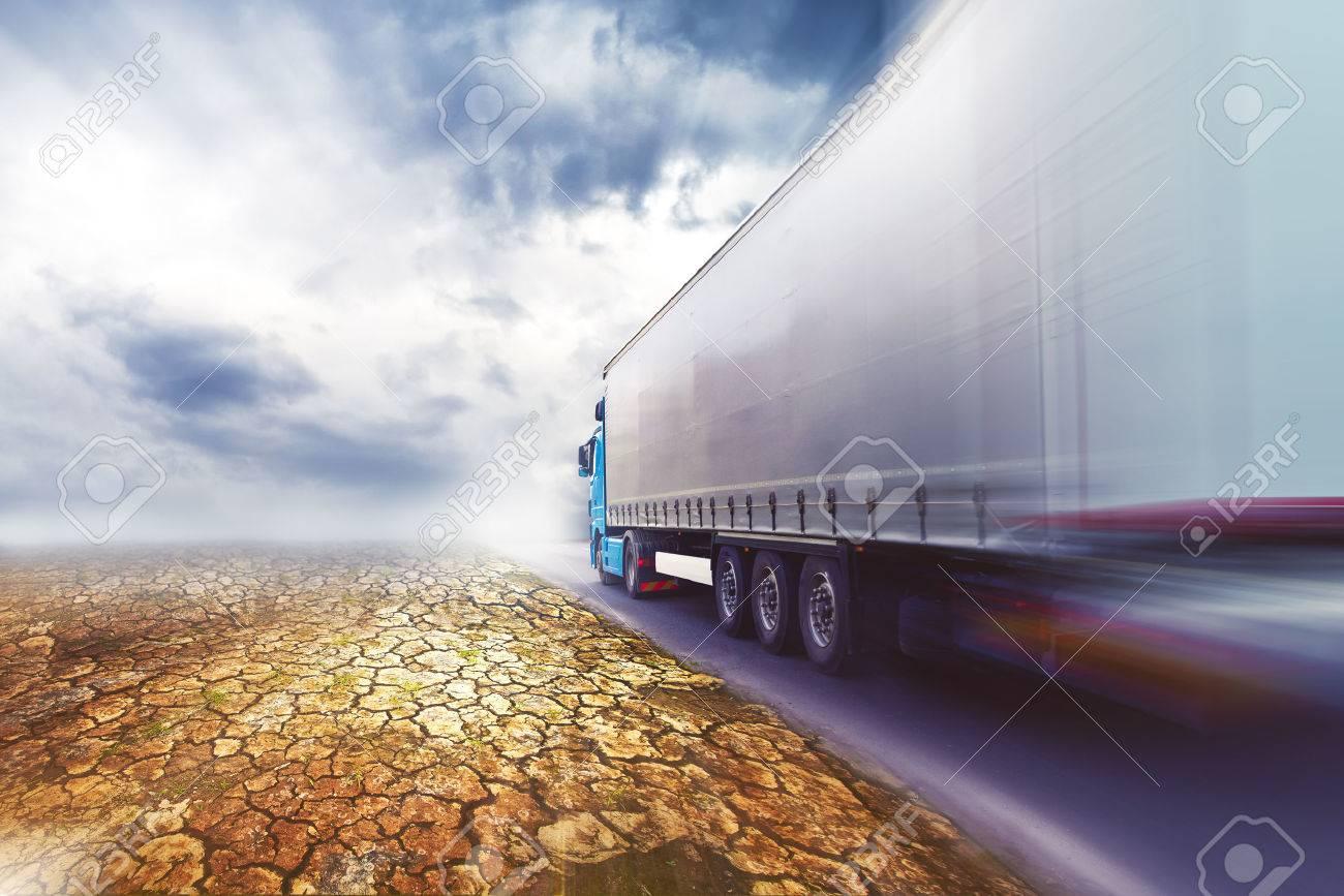 Speeding Transportation Truck driving on the road through the desert. - 33670433