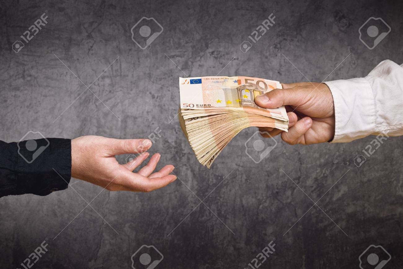 Money Loan. Bank officer loaning stack of euro banknotes money. - 34130515