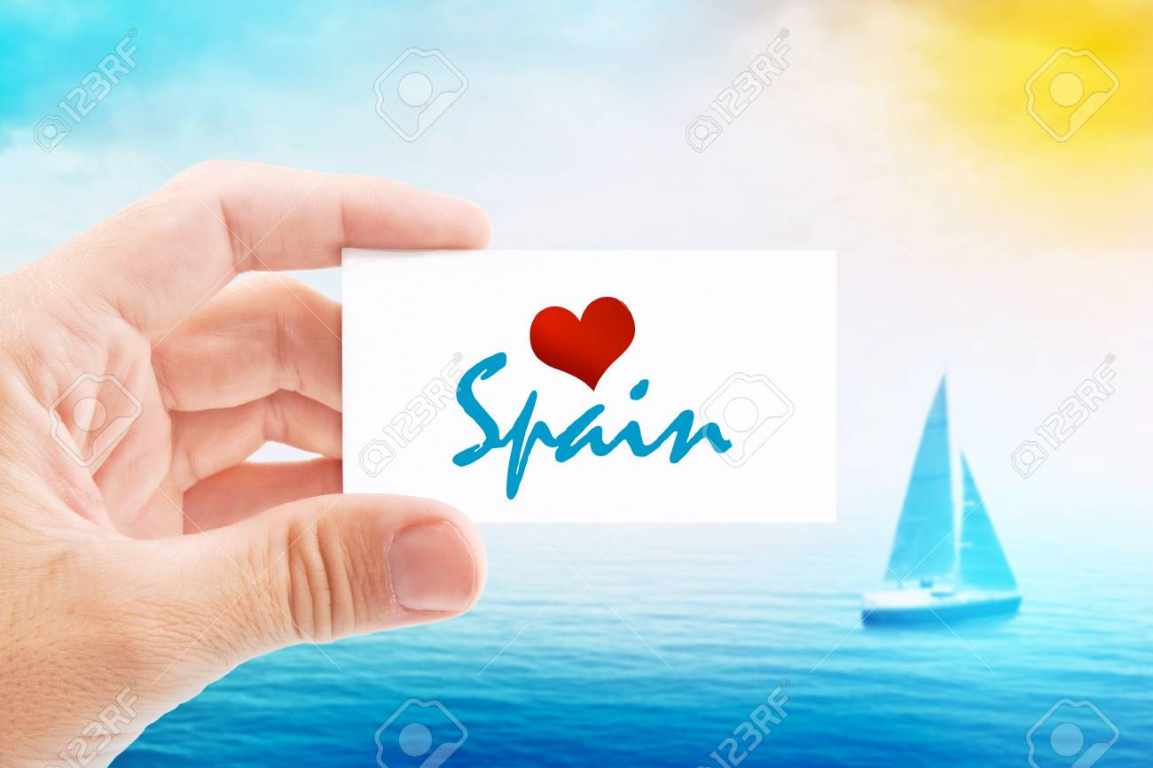 Summer vacation on spanish beach person holding visiting card stock photo summer vacation on spanish beach person holding visiting card for summertime holiday message love spain and sailboat at sea in background colourmoves