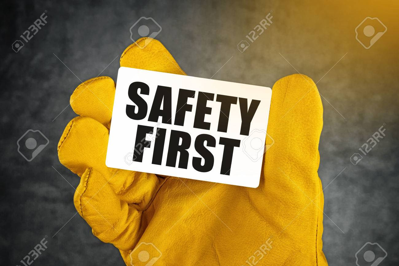 Safety first on business card male hand in yellow leather safety first on business card male hand in yellow leather construction working protective gloves holding colourmoves