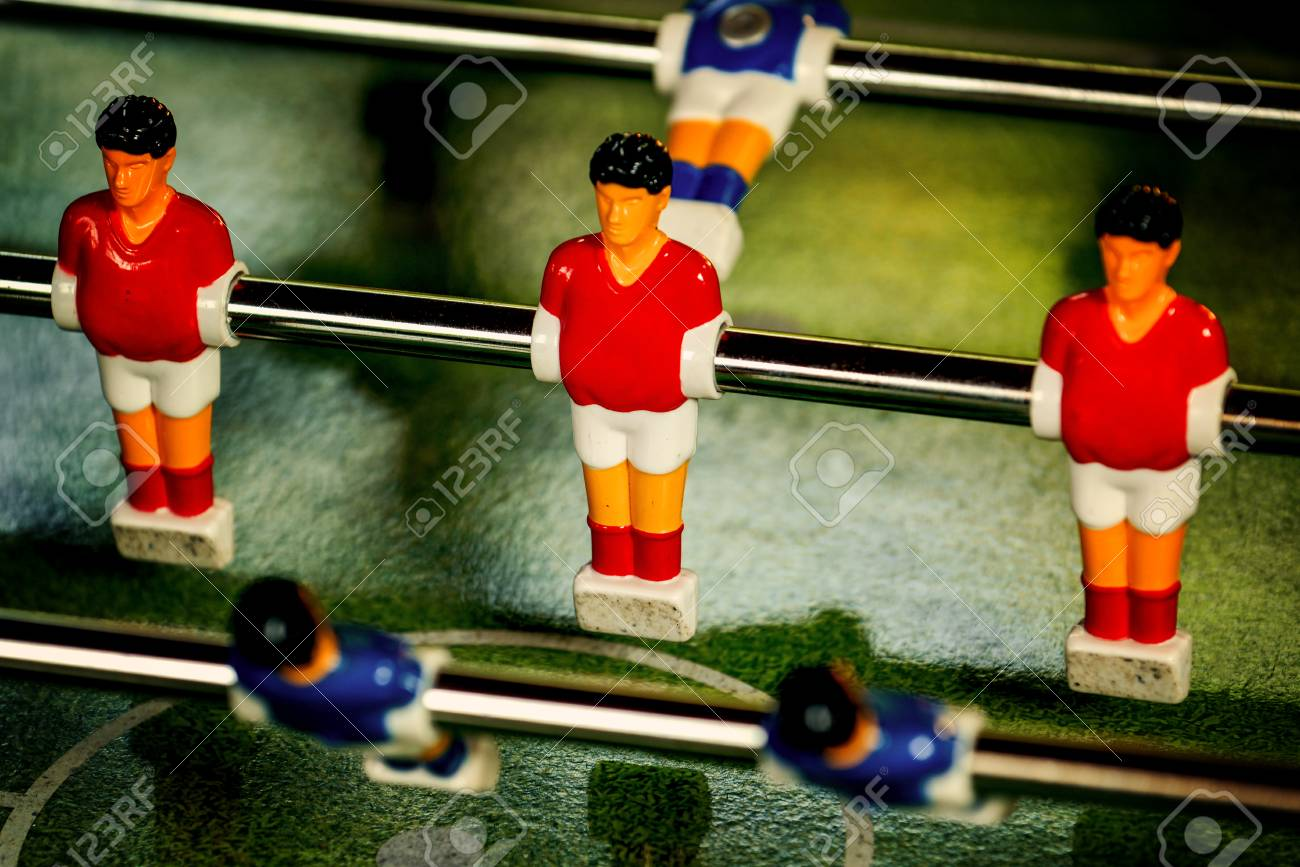1ce2c50d9 Stock Photo - Vintage Table Soccer Player Figures in Blue and Red Team  Jerseys