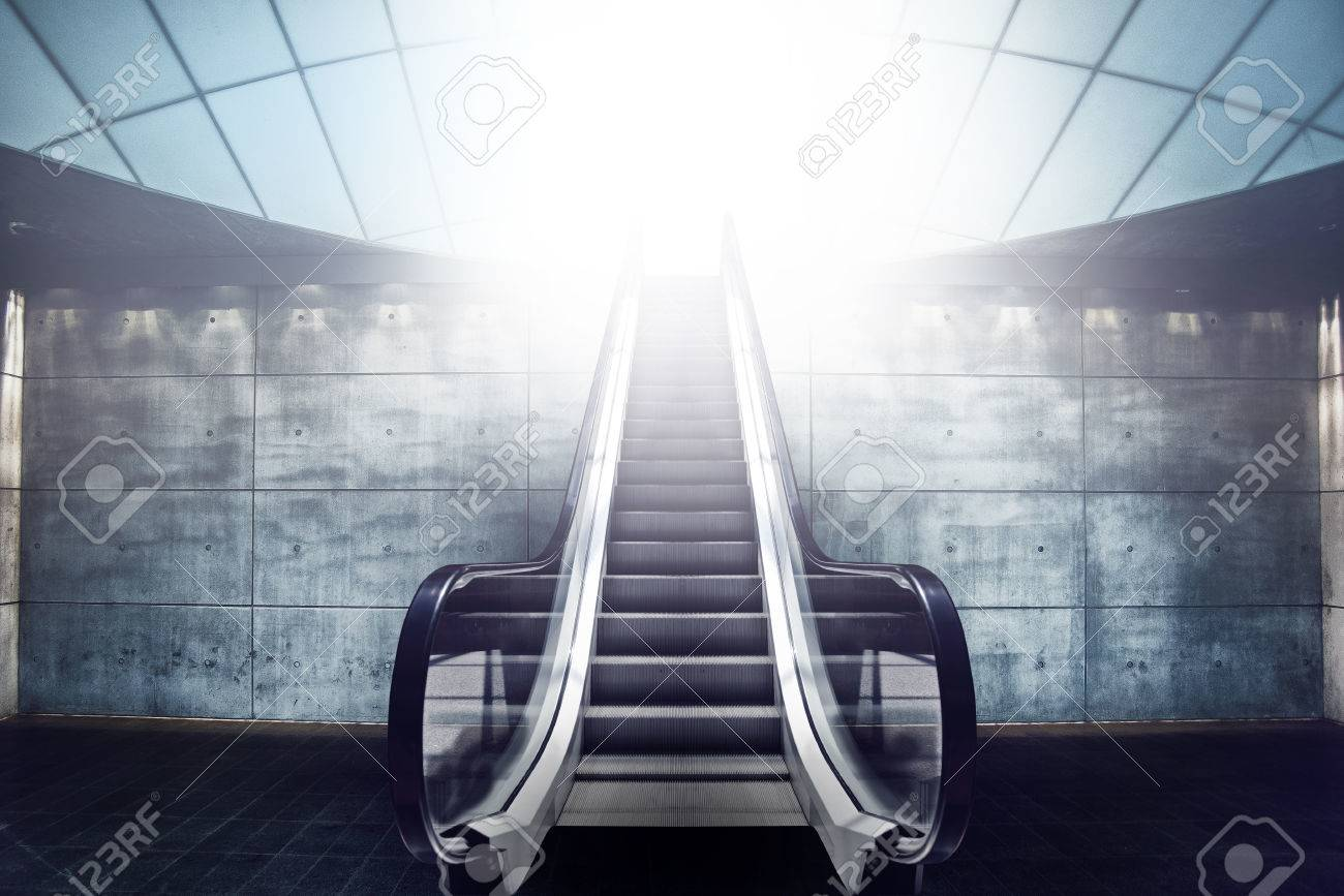 Escalator staircase and exit to light modern concrete architecture