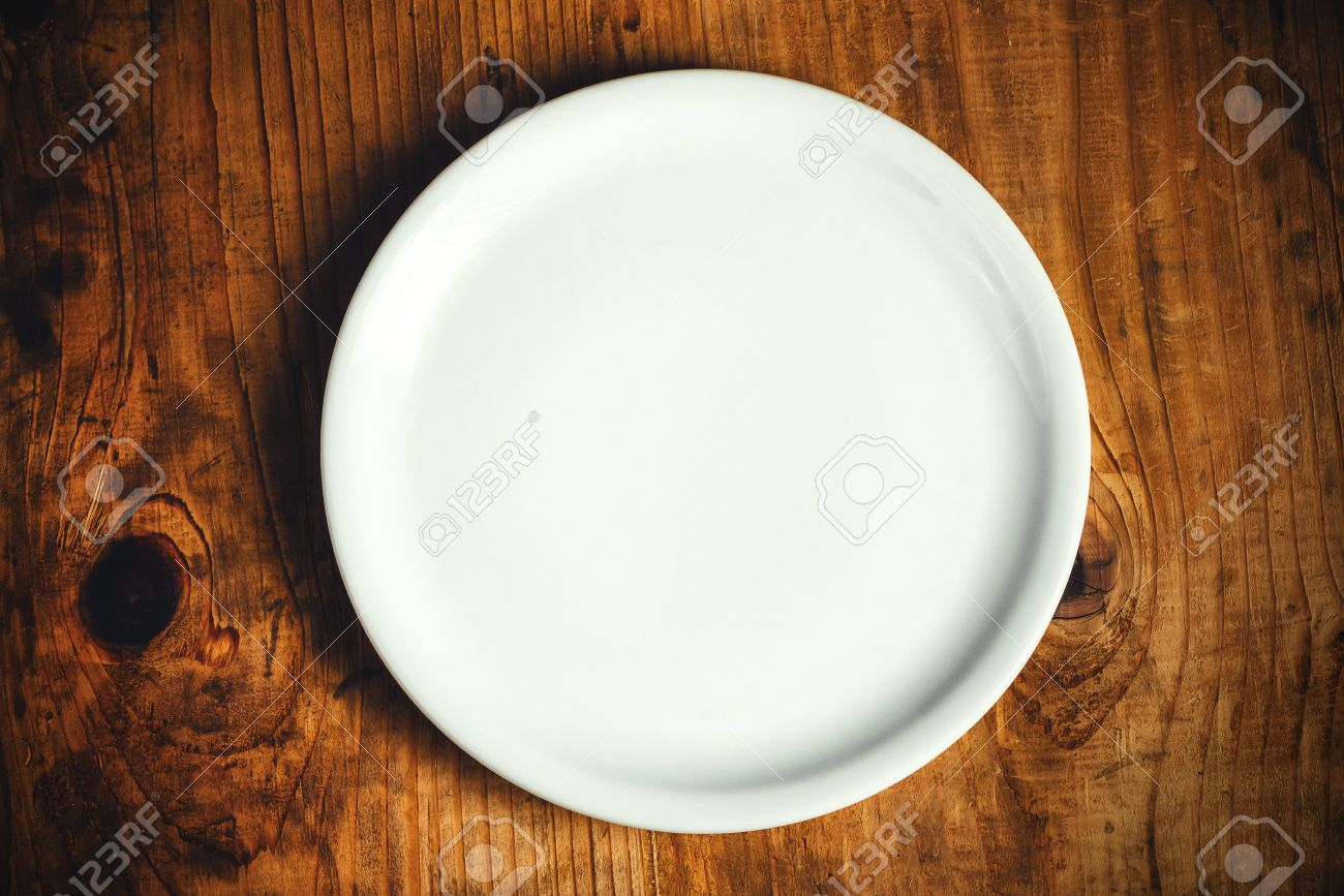 Kitchen table top view - Empty White Dinner Plate On Rustic Wooden Kitchen Table Top View Stock Photo 50260255