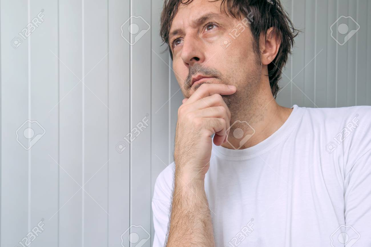 Man with hand on chin thinking deep thoughts and making tough
