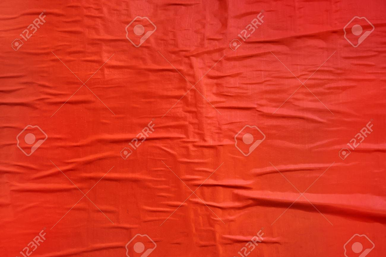 Printed red poster paper texture, crumpled billboard material glued to a wall, useful as background - 74511182