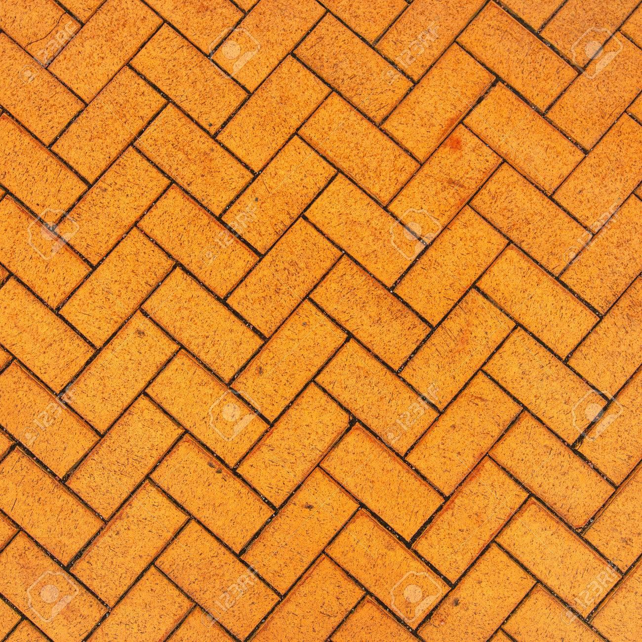 Orange Zigzag Brick Paving Texture Top View Sample Of Urban Background Stock Photo