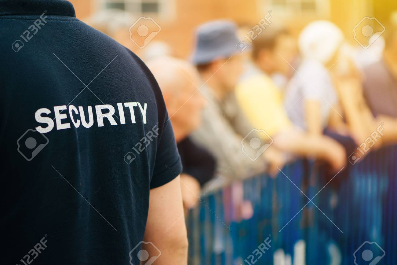 Member of security guard team working on public event, unrecognizable male person from behind - 78749800