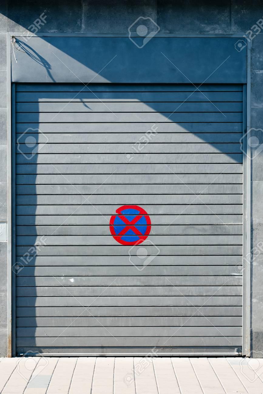 Garage Door With No Parking Sign Urban Background Stock Photo