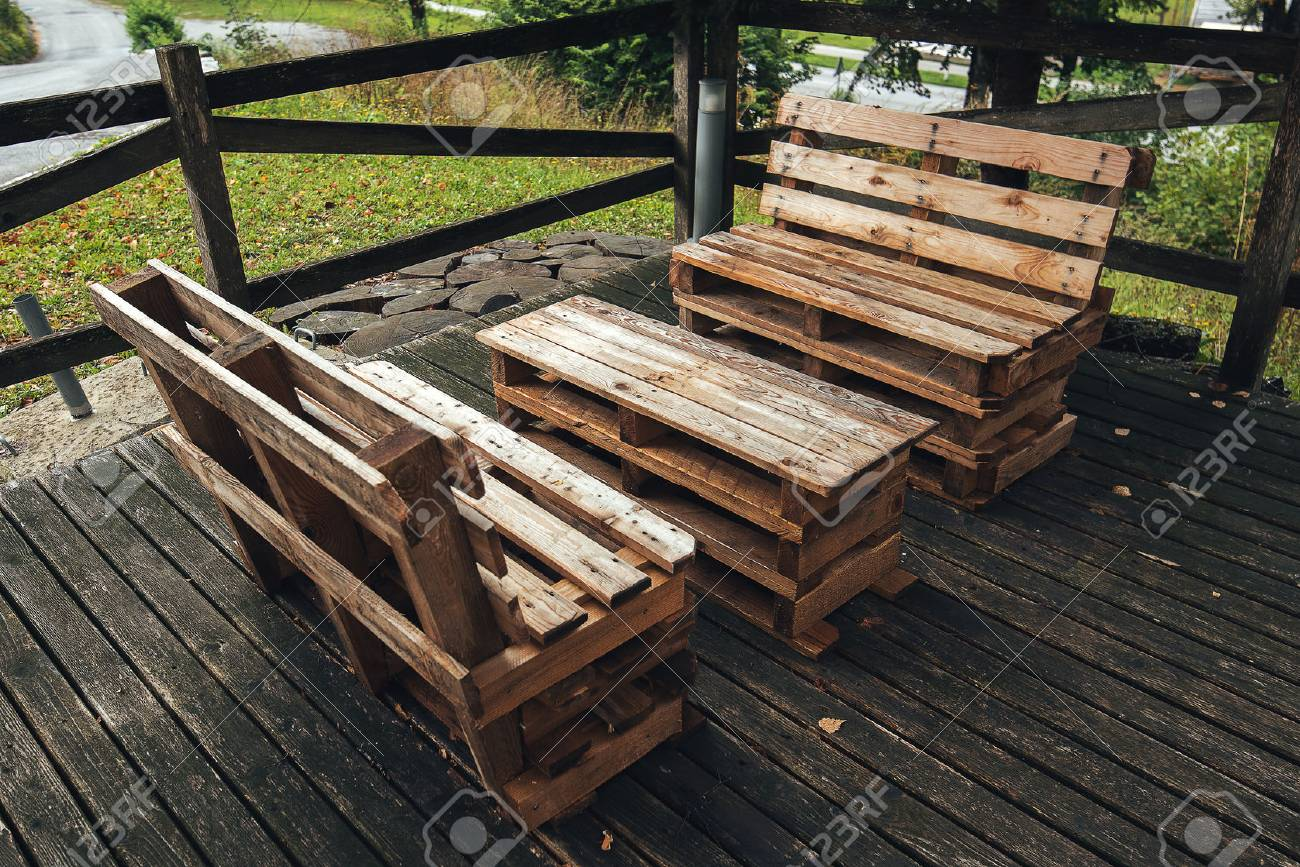 DIY pallet outdoors furniture in house backyard, selective focus - 88489096