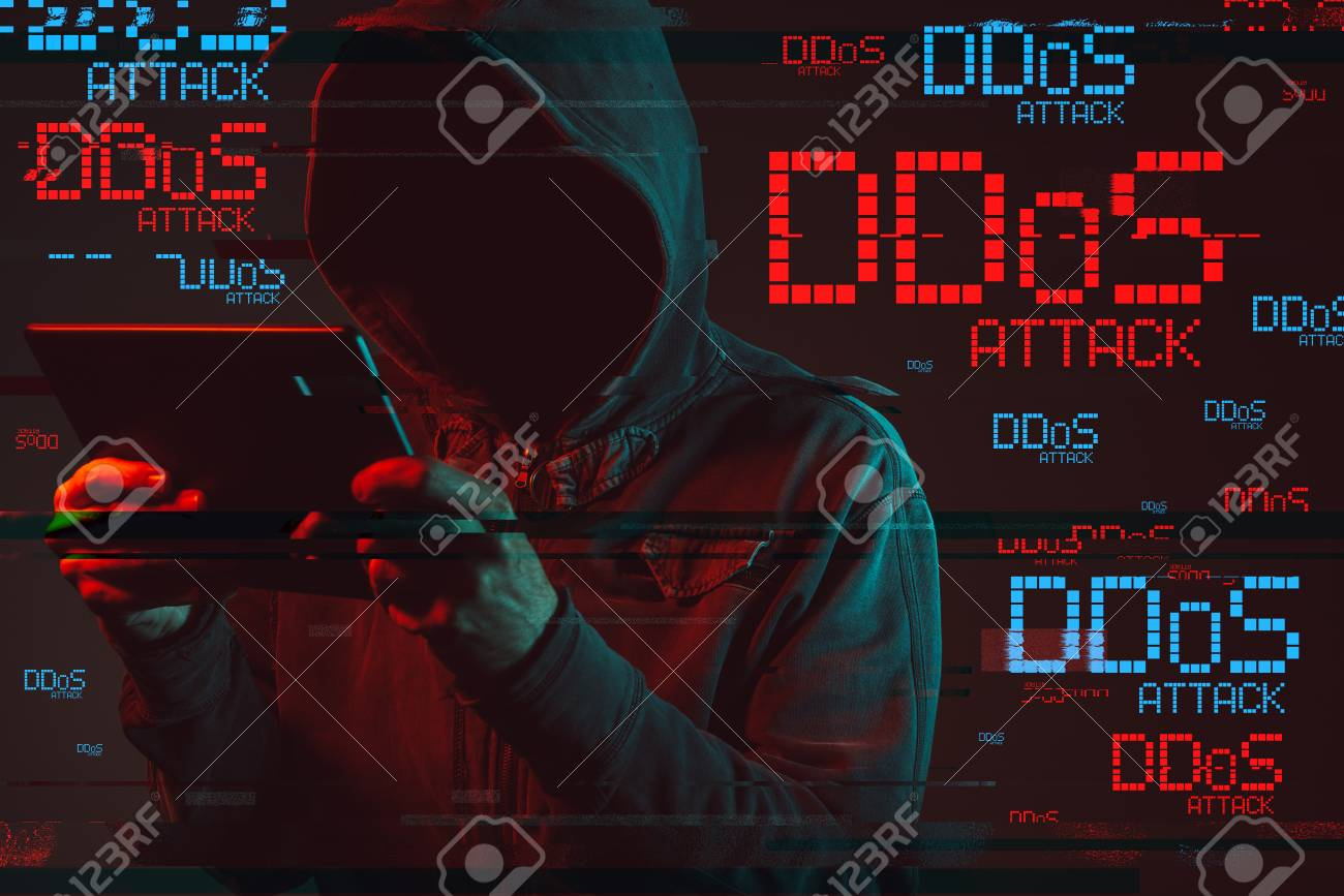 Distributed denial of service or DDoS attack concept with faceless hooded male person using tablet computer, low key red and blue lit image and digital glitch effect - 99662788