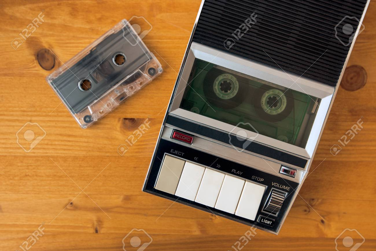 audio cassette tape rolling in vintage player on the desk top