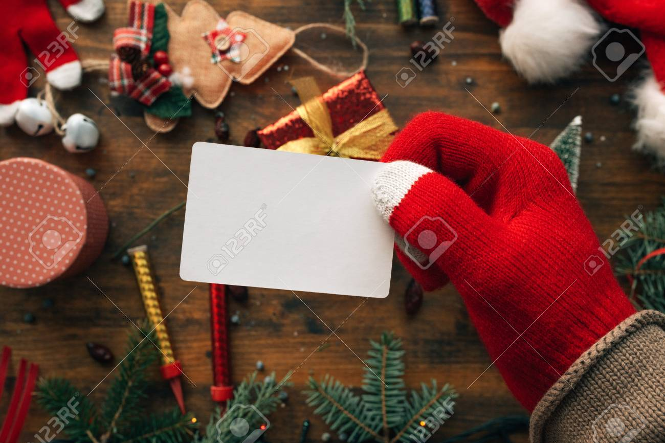 Christmas Business Decorations.Christmas Business Card Mock Up Held By The Hand Over Table With