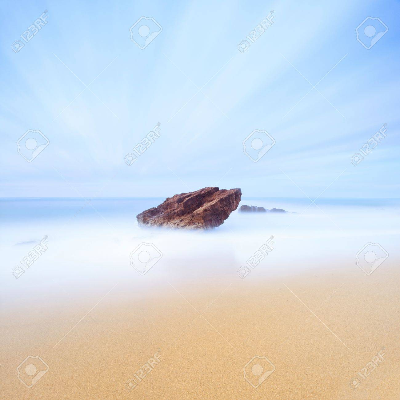Rock, sea and gold sand seascape  Seven minutes long exposure photography  Italy Stock Photo - 14895247
