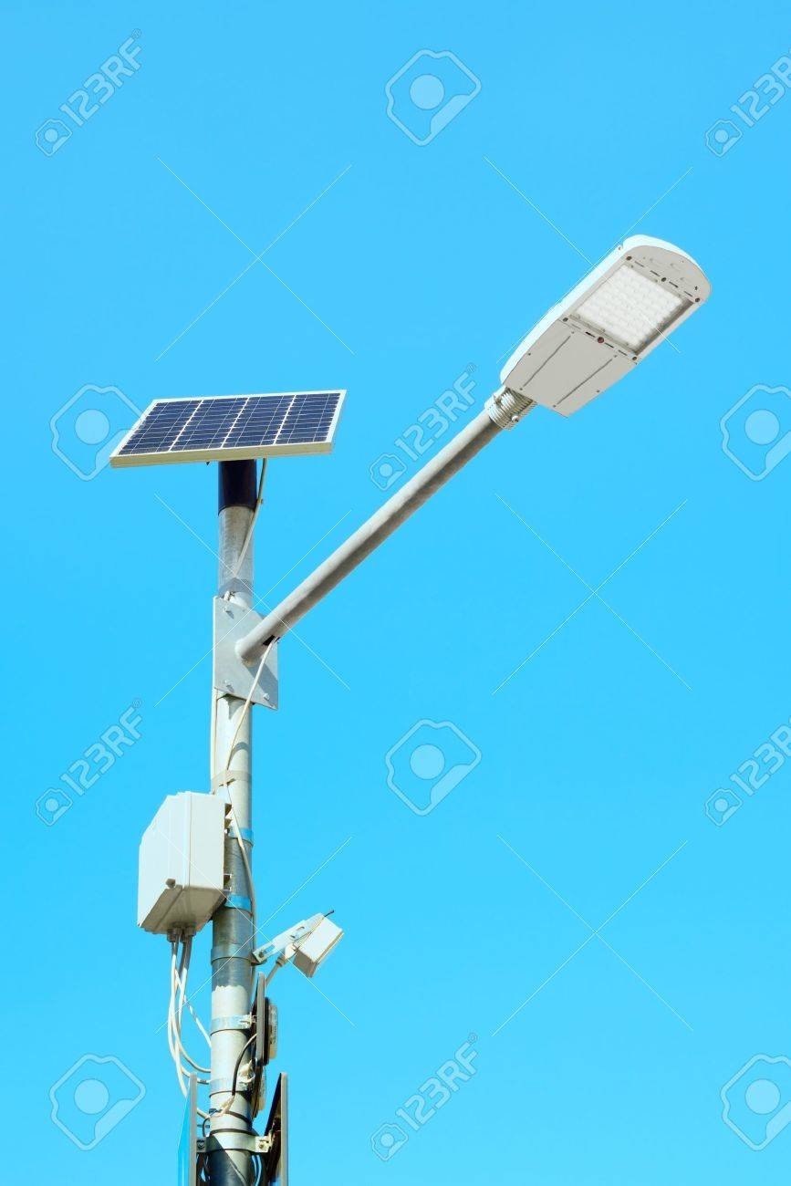 Solar panel cell powered street light lamp on a blue sky background Stock Photo - 15660822