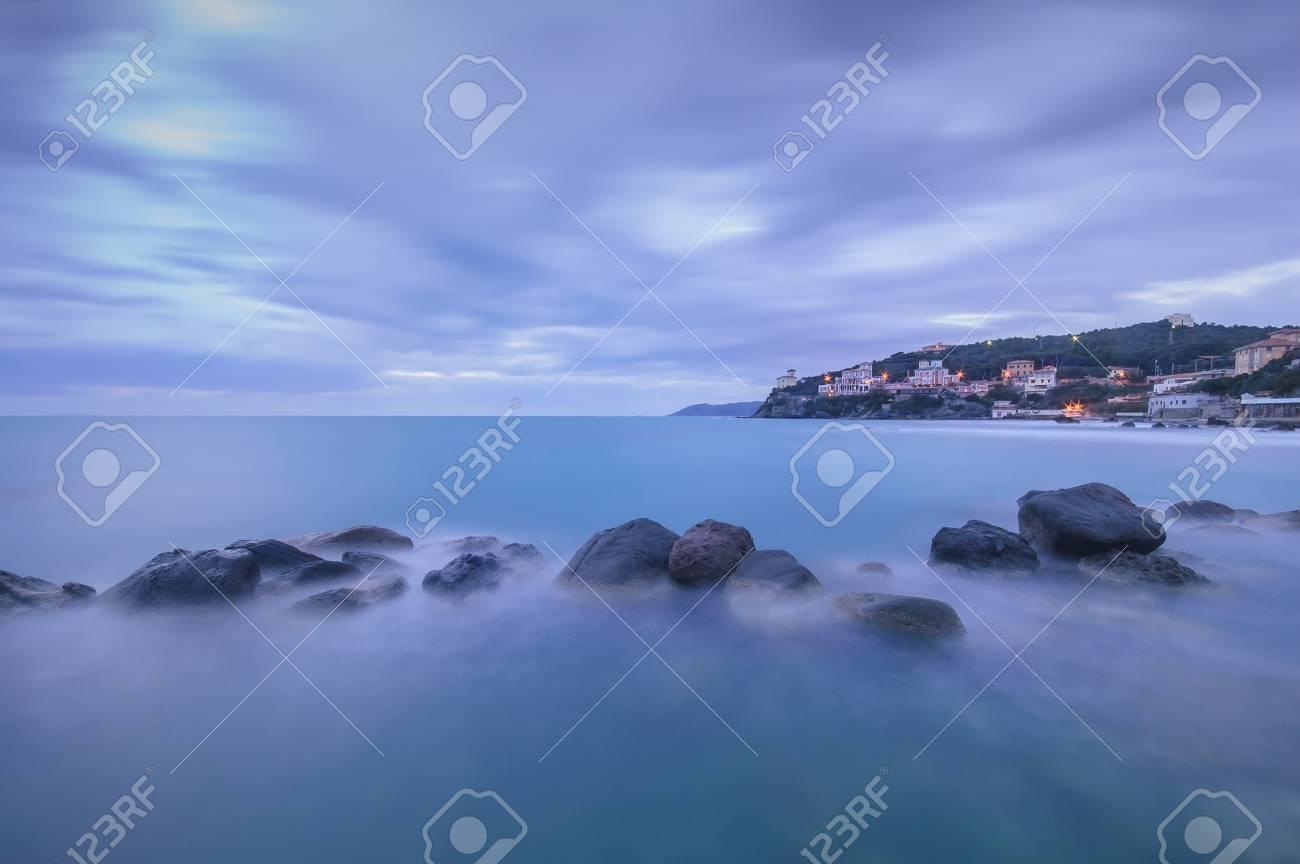 Dark Rocks in a blue ocean on twilight  Castiglioncello, Tuscany, Italy  Long exposure photography Stock Photo - 17445409