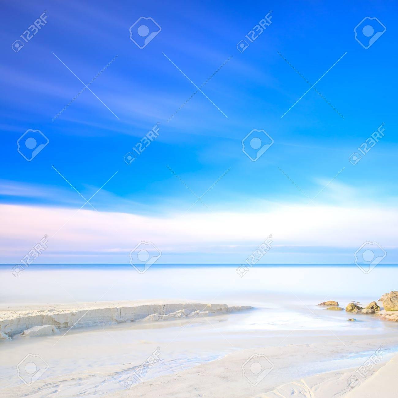 White sand dunes beach, rocks, blue ocean and sky on background Stock Photo - 17811075