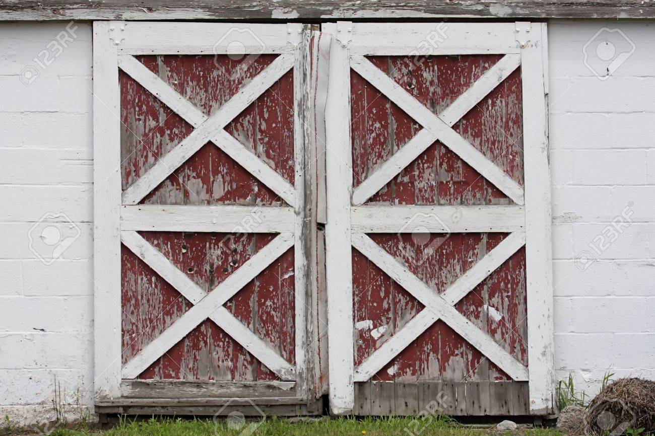 Rustic Old Red And White Barn Doors With Peeling Paint Stock Photo
