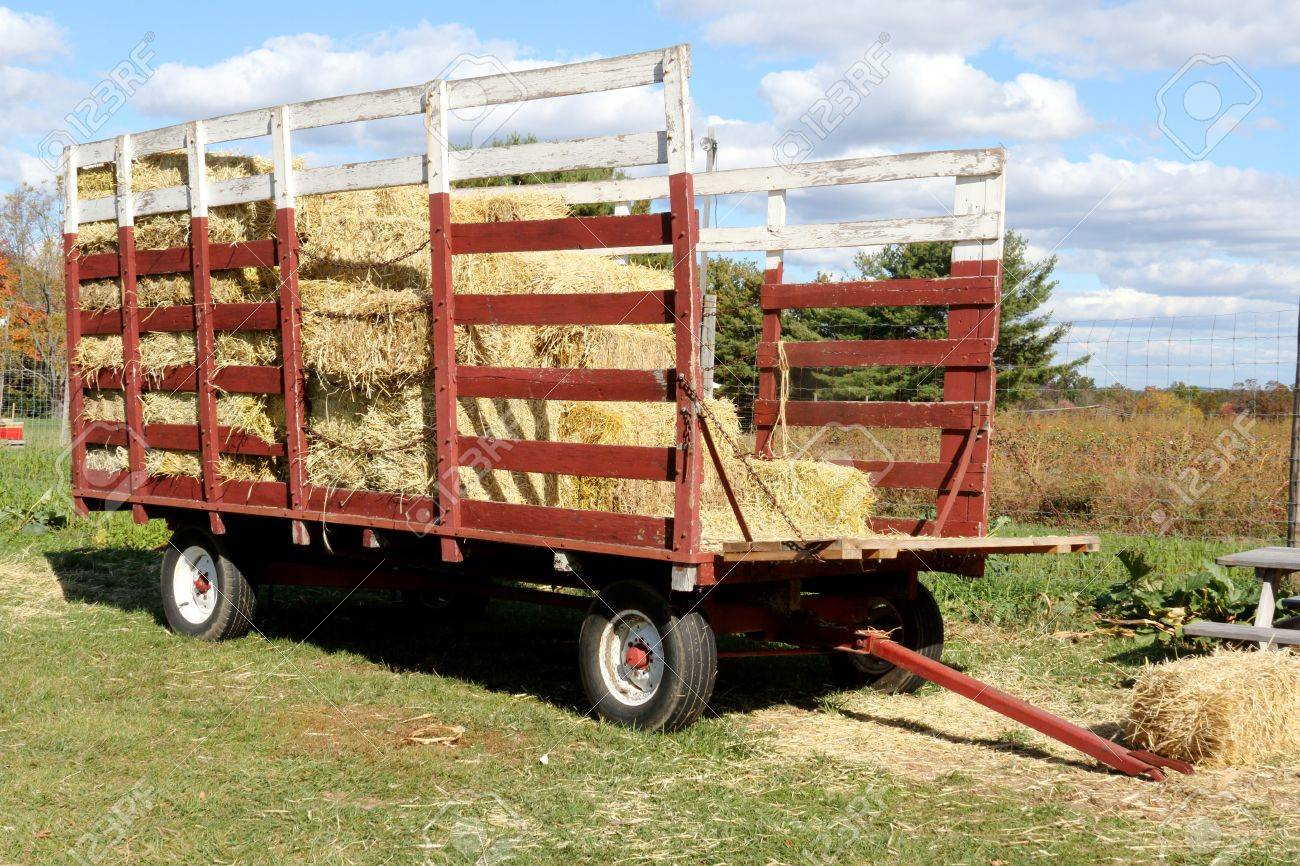 Rustic Old Red Hay Wagon In A Farm Field In Fall Stock Photo Picture And Royalty Free Image Image 65966339