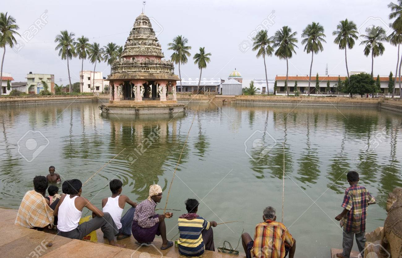 Local men fishing in the village of Karaikudi in the Chettinad