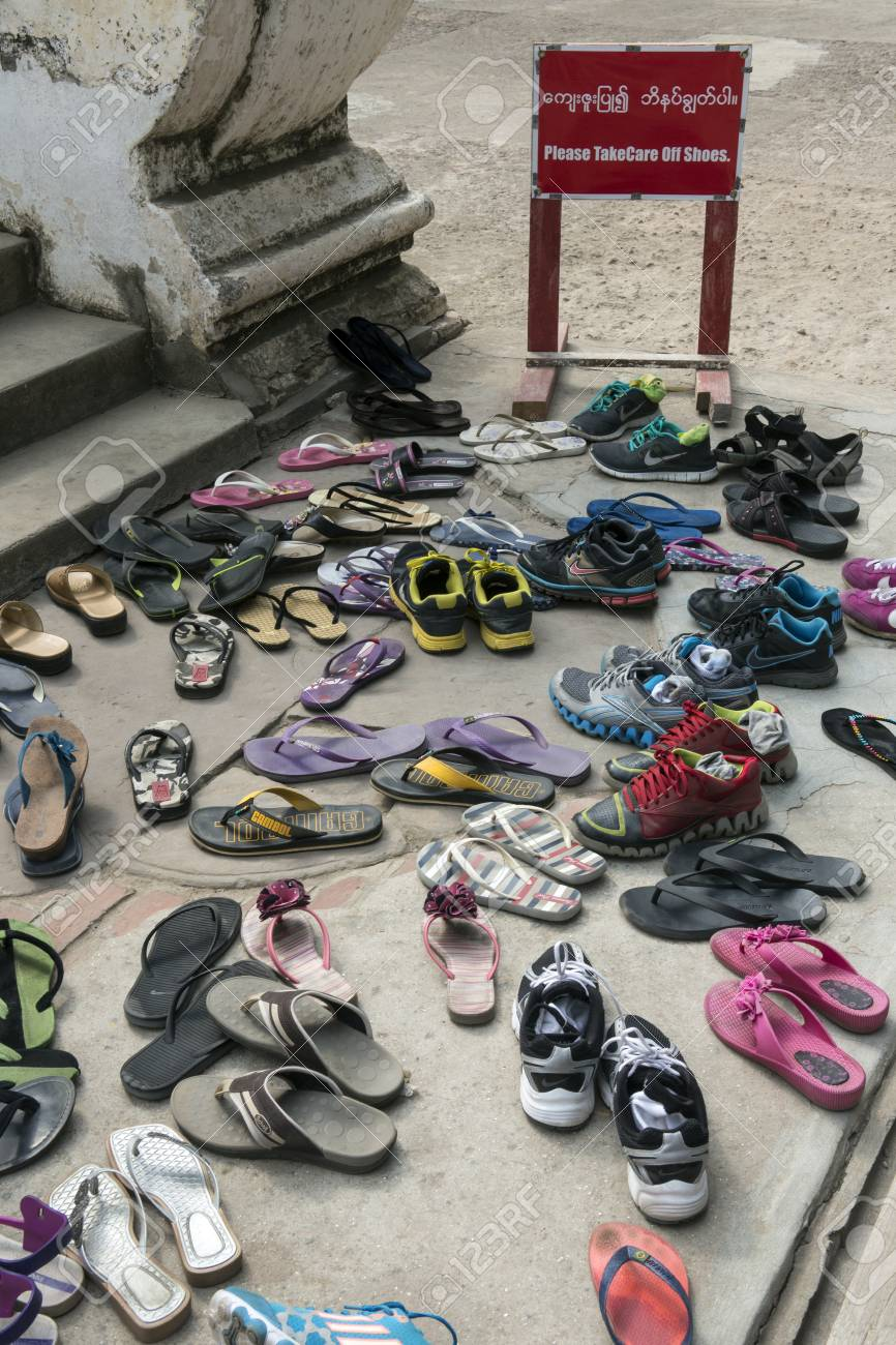 8caba2932d83 Shoes at the entrance to a Buddhist temple in Mandalay in Myanmar - Burma  Stock Photo