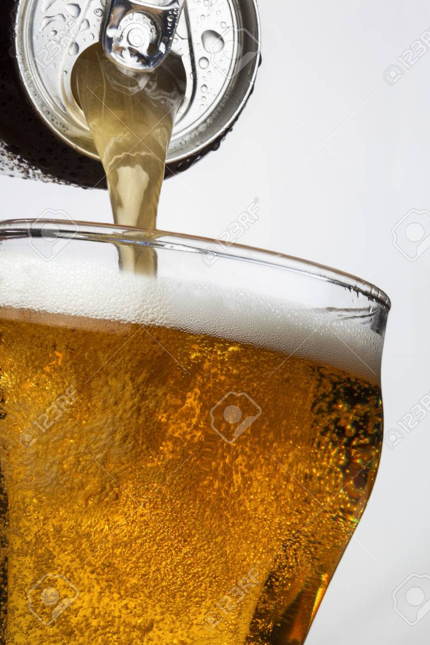 pouring ice cool beer from a ring pull can stock photo picture and