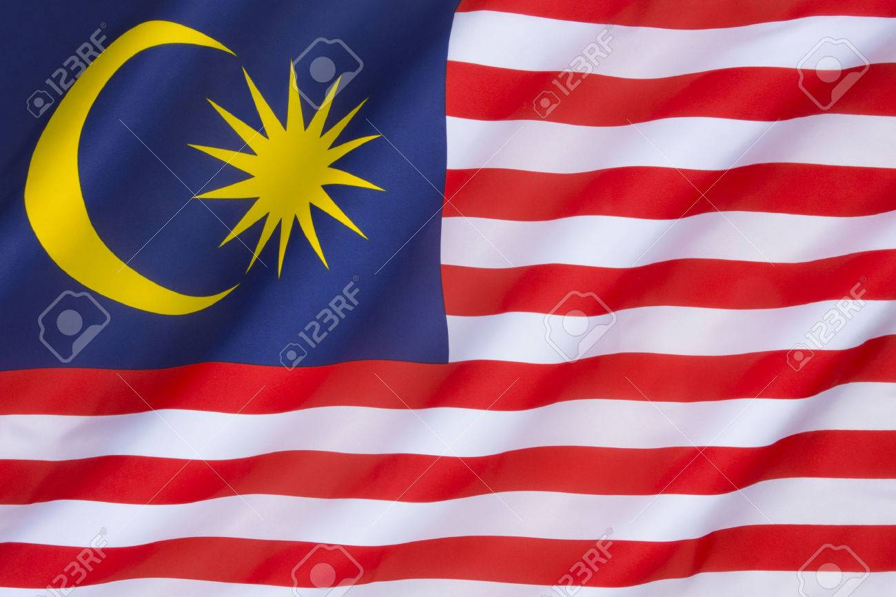The national flag of Malaysia, also known as the Jalur Gemilang (Malay for Stripes of Glory). The flag was first raised on 16th September 1963, and originated from the flag of the Federation of Malaya. - 35874370