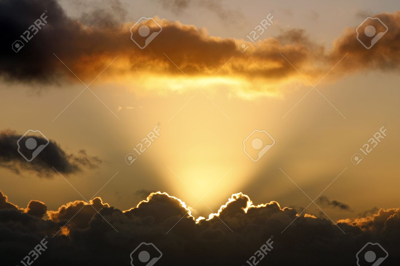 Sun rays and dark clouds at sunset - 11785859
