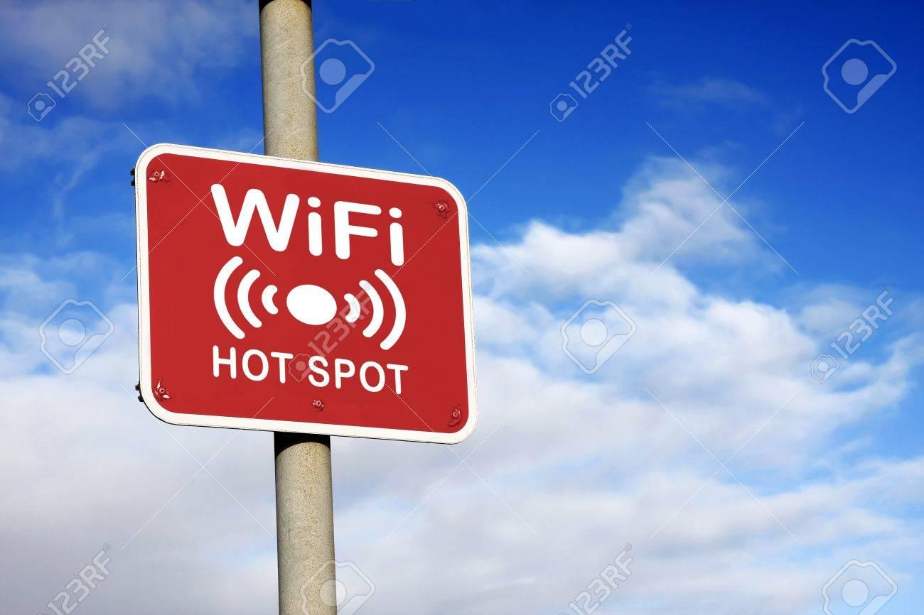 WiFi hotspot sign against a blue sky - 15734886