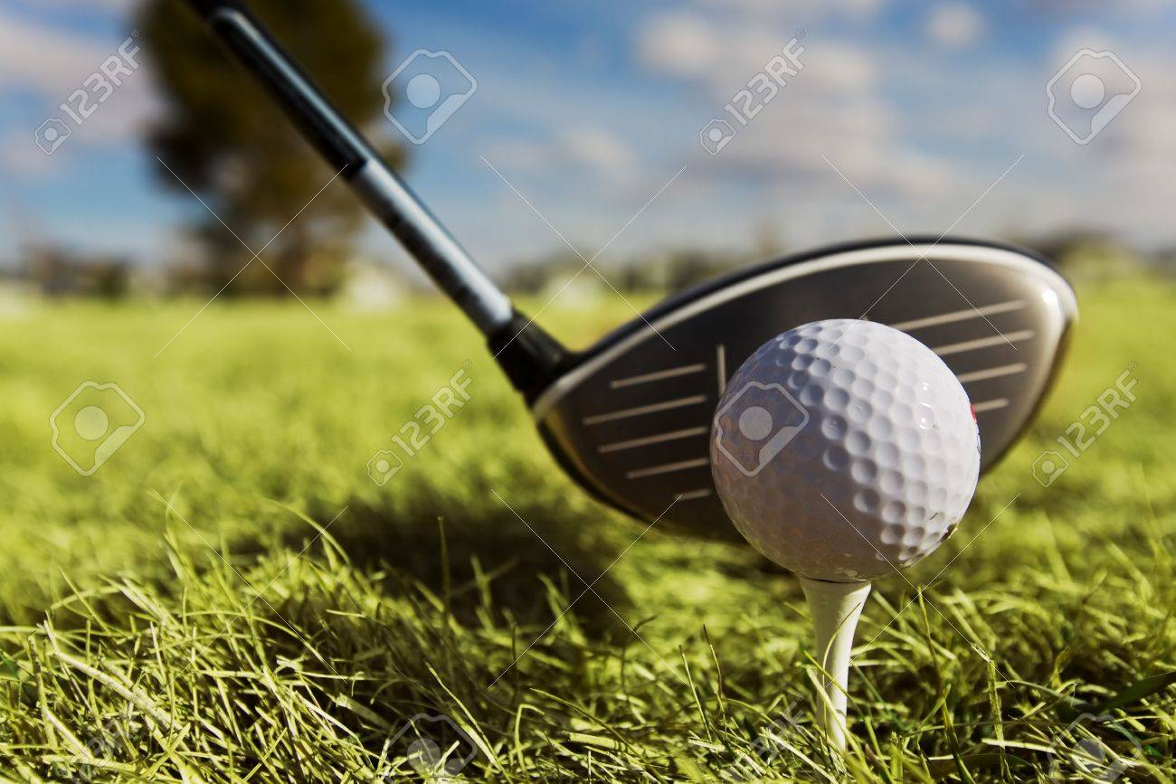 A golf ball and driver with focus on the ball Stock Photo - 2808061