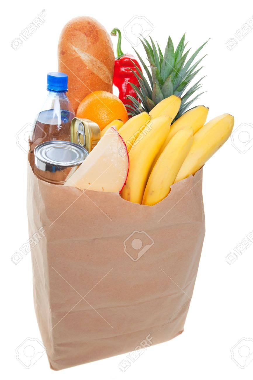A grocery bag full of  healthy fruits and vegetables Stock Photo - 8258815