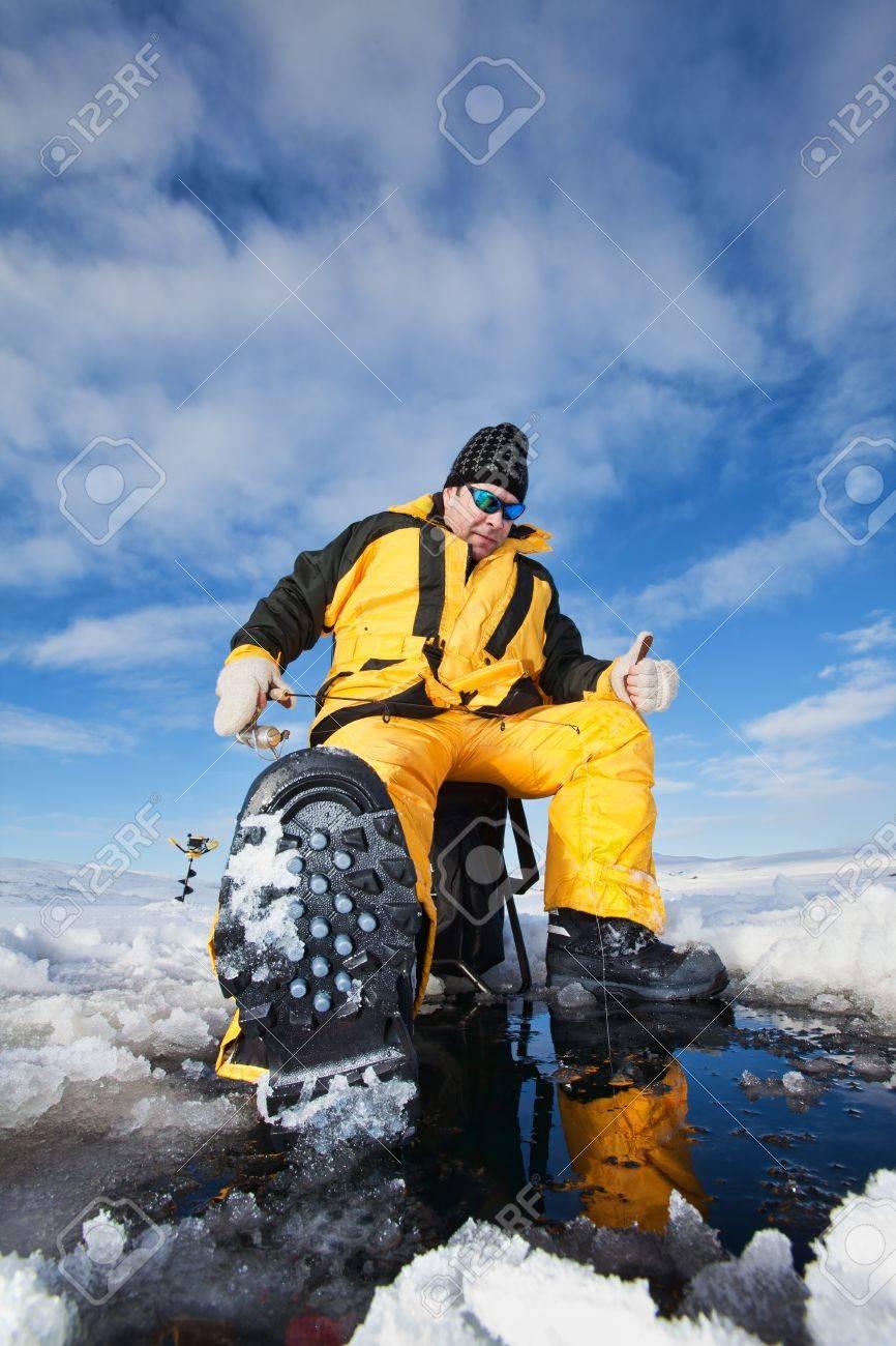 Happy fisherman in winter ice fishing Stock Photo - 8612809