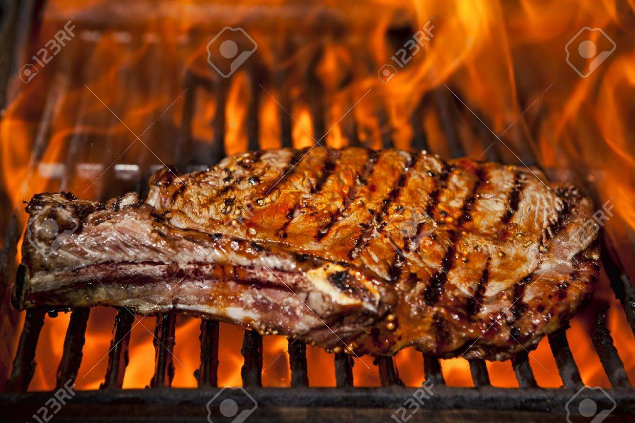 A top sirloin steak flame broiled on a barbecue, shallow depth of field. Stock Photo - 13946655