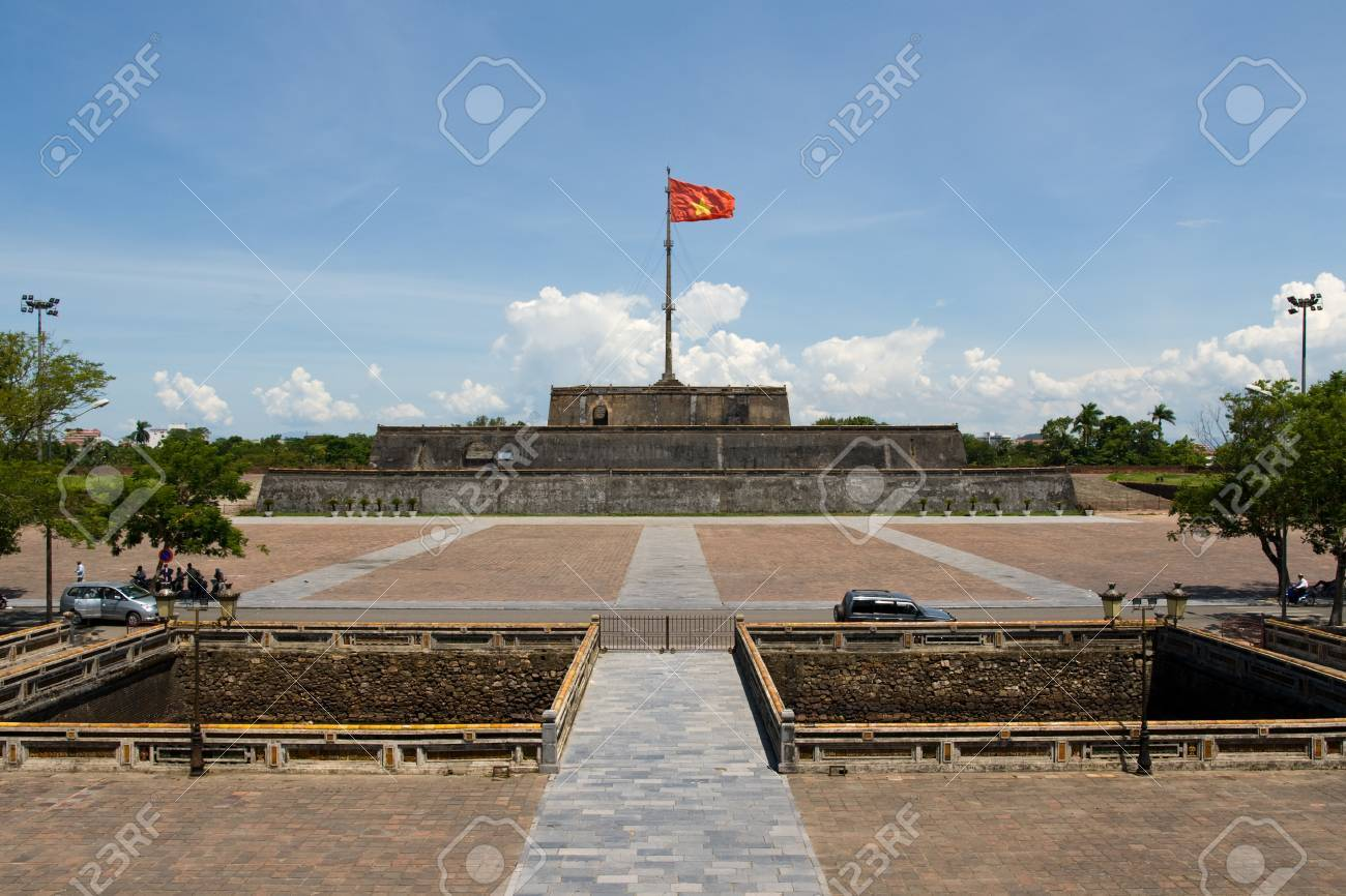 Vietnam flag standing on flag pole above historic hue citadel vietnam flag standing on flag pole above historic hue citadel wall stock photo 49287370 sciox Image collections